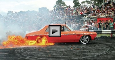 blown-v8-hot-rod-catches-fire-in a Burnout Competition