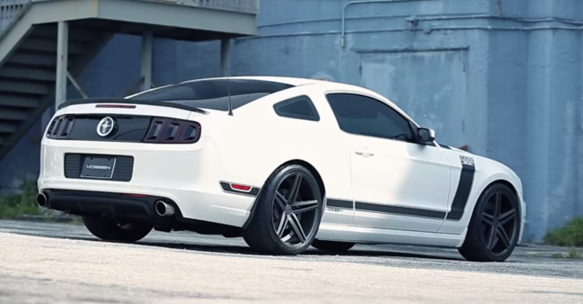Ford Mustang Boss 302 riding on 20 inch vossen wheels