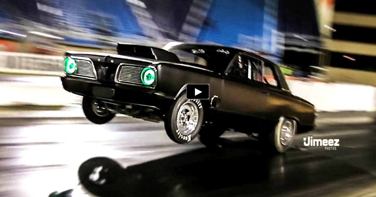 wheelstanding 1966 plymouth valiant drag racing