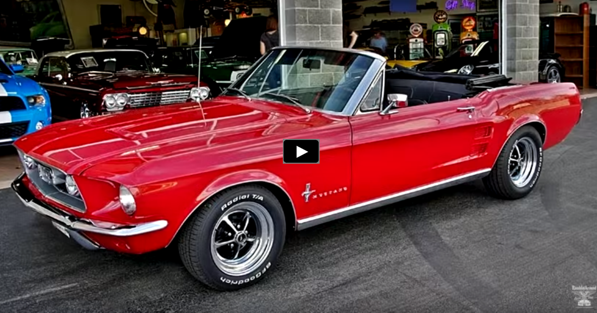 convertible 1967 mustang in candy apple red