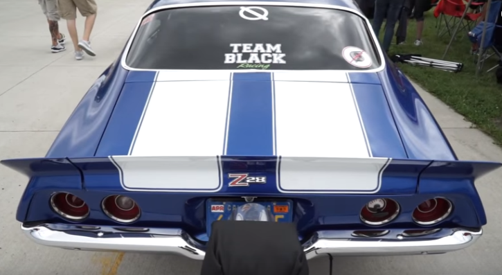 team black 1970 chevy camaro z28 drag racing