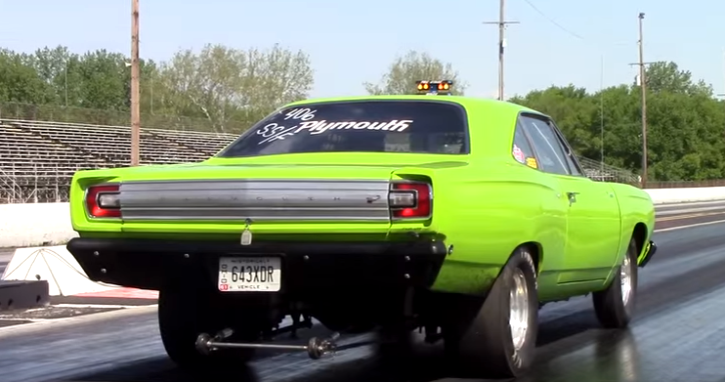 green plymouth road runner drag racing at national trails raceway