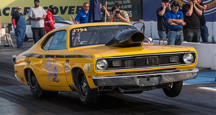 yellow 1972 plymouth duster drag car